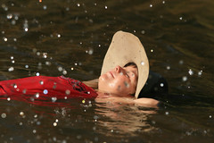 Simple Dreaming (robertdownie) Tags: sky red girl water light summer lady simple floating australia droplets had queensland sparkle far north fnq
