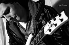 Mishkin (Moira_Fee) Tags: boy portrait musician music white man black blanco look leather fashion studio looking shot gorro guitar good guitarra negro moda player blanca editorial chico moira intimate mirada hombre fee guitarrista hera riff chaqueta abrigo intimo raff amaranto musico