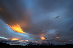 Golden hours at Torres del Paine Patagonia IMG_9749 (pr.cuenod) Tags: chile park travel patagonia southamerica nature yellow clouds landscape chili granite torresdelpaine patagonie monoliths puertonatales parquenacionaltorresdelpaine americadelsur goldenhours magellanes rioserranohotel