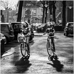 Biking Woerden (John Riper) Tags: street trees girls bw white black netherlands monochrome kids canon john square photography mono cycling women zwartwit candid streetphotography bikes bicycles biking ah 6d woerden 24105 vierkant albertheyn straatfotografie riper johnriper