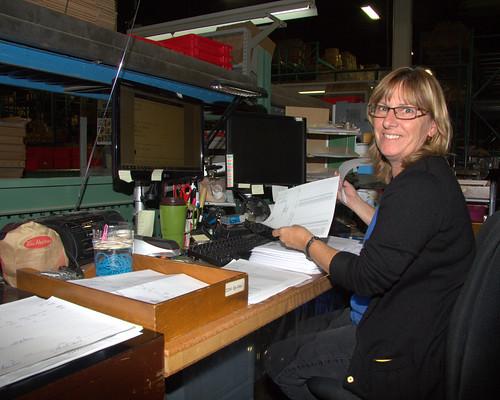 Female Worker Holding Form / Travailleuse tenant un formulaire
