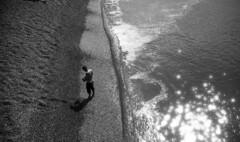 Calm (4foot2) Tags: calm sea seafront seaside seawater candidportrate candid man swimmer people peoplewatching peopleofbrighton interestingpeople brighton beach brightonbeach summer sun lookingdown pier palacepier brightonpier analogue film filmphotography 35mmfilm 35mm 35mmf35 35mmf35summaron summaron leica 1932 1932leica leica111 rangefinder bw blackandwhite monochrome mono polypanf standdevelop hc110 kodak 2016 fourfoottwo 4foot2 4foot2photostream 4foot2flickr