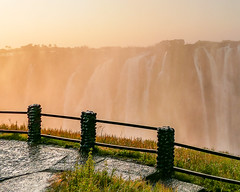 Sunset Victoria Falls (MarcCooper_1950) Tags: waterfall victoriafalls wondersoftheworld water river sky zambia dramatic vivid hdr color fz1000panasonic lumix leica marccooper rails fence posts railing
