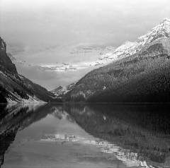 the edge of Louise (rockpowered) Tags: bw mountain lake snow 120 film analog scanner louise alberta banff mf pentacon six acros xtol 80mm biometar