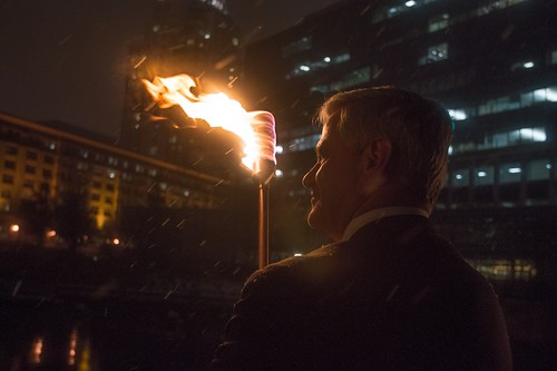Lt. Governor Dan Mckee holds a torch during the WaterFire Lighting Ceremony. Photo by Jen Bonin.