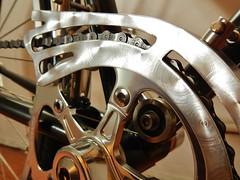 Swirly Chain Guard (guidedbybicycle) Tags: city urban orange bike bicycle stem aluminum bell crane handmade steel frame commuter custom velo quill fenders lug nitto lugs lugged 1x9