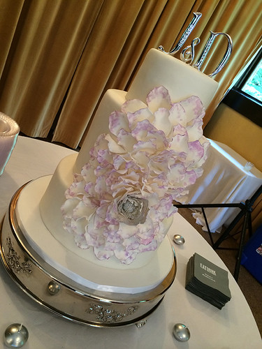"""One large sugar rose from a silver center on this four tier wedding cake. • <a style=""""font-size:0.8em;"""" href=""""http://www.flickr.com/photos/50891271@N03/15727173253/"""" target=""""_blank"""">View on Flickr</a>"""