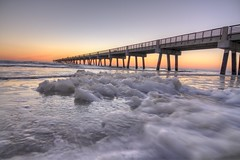 Sunrise (Royal Hurlbert) Tags: city bridge trees sunset beach water sunrise outside outdoors pier dock waves driftwood