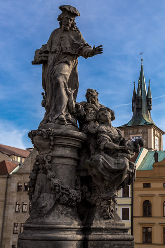 A beautiful statue of poor family asking the merchant to take them on a boat. Charles Bridge Prague