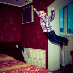 Flying boy 1 (ValeTer_) Tags: boy portrait shirt children flying jump bedroom magic jeans pavel