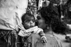 The only thing next best to a Mom's kiss is another kiss from her.. (Mahendiran Manickam) Tags: blackandwhite baby love mom kiss wish cwc chennaiweekendclickers mahemanickphotography