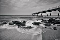 The recoil (David Martn Lpez) Tags: barcelona longexposure bridge blackandwhite seascape blancoynegro beach water landscape puente agua rocks stones silk playa paisa