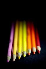 Some more color pencils (lizarraga91) Tags: pink red orange black macro colors yellow blackbackground nikon ngc peach mustard crayon colorpencil d3200 blackandcolor nikonflickraward