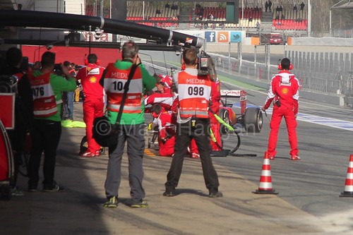 The media watch Kimi Raikkonen have a pit stop at Formula One Winter Testing 2015