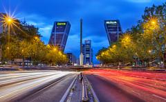 Madrid Cityscape 7961 (kbaranowski) Tags: 2016krzysztofbaranowski krzysztofbaranowski spain cityscape touristattraction famousplace touristdestination buildingexterior urban urbanlandscape madrid lighttrail lightstream torres highway bluehour cloud
