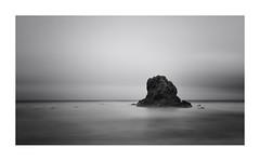Stranded (Lindi m) Tags: longexposure sea seascape mono nikon rocks cornwall minimal coastal seastack lightroom