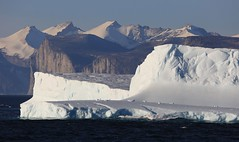 Icebergs Approach into Gibbs Fiord 3 Baffin Island Canada High Arctic - EXPLORED (eriagn) Tags: travel sea summer panorama canada ice expedition vertical reflections spectacular landscape ancient rocks distorted patterns cliffs glacier arctic erosion explore ramparts granite inuit northamerica mirrored remote fjord iceberg zodiac geology coal habitat volcanic nunavut fiord sedimentary tranquil magnificent fossils stroch sheer stupendous mirroring otherworldly baffinisland weathering topography schist glaciation metamorphic canadianshield gneiss explored gibbsfjord akademikioffe oneocean inexplore naturesabstract eriagn ngairelawson ngairehart 70thanniversaryofthestroch scottinlet