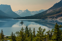 The smallest island... the biggest landscape charm (JoLoLog) Tags: trees usa lake mountains reflection montana mt rockymountains raya glaciernationalpark stmarylake lorien gnp wildgooseisland manyglacier canonxsi