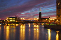 City of shifting light (Jens Haggren) Tags: longexposure light sky water clouds reflections lights colours sweden stockholm cityhall olympus omd em10