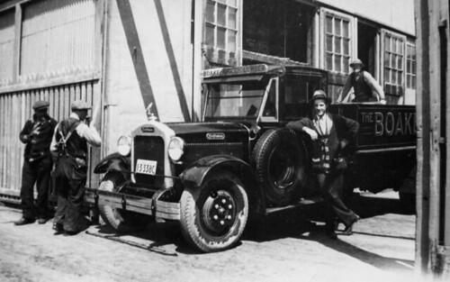 Male Leaning Against Truck / Homme contre un camion