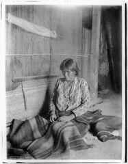 Navajo Indian woman blanket maker with blankets and loom, ca.1901-1903 (CHS-3261)