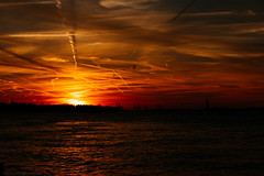 Lava sunset (Marco Germinario) Tags: new york sunset ny newyork statue skyline liberty freedom tramonto albany helicopters chemtrails 2014 2015