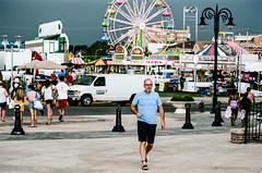 back to the boardwalk (mfauscette) Tags: 35mm fsc ishootfilm istillshootfilm kodak kodakportra800 nikon nikonf6 analog asburypark beach boardwalk fence film filmisnotdead filmshooterscollective jerseyshore street