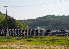 Bags of radioactive waste during radioactive decontamination process after the daiichi nuclear power plant irradiation, Fukushima prefecture, Iitate, Japan (Eric Lafforgue) Tags: ecology japan horizontal danger outdoors japanese unsafe dangerous energy asia risk environmental cleanup radiation nobody nopeople forbidden pollution disaster environment radioactive radioactivity bags copyspace waste atomic fukushima hazard atom catastrophe exclusion contamination decontamination contaminated daiichi radioactivewaste 0people nuclearaccident fukushimaprefecture irradiate atomicwaste decontaminating iitate colourpicture nuclearindustry fukushimaexplosion fukushimadisaster japan161839