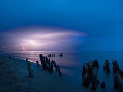 Fury Approaches (MacDonald_Photo) Tags: jamieamacdonald olympus omd omdem5markii 43 mft microfourthirds trailblazer olympustrailblazer httpwwwjmacdonaldphotocom zuiko zd em5mkii em5markii lakemichigan lightning storm puremichigan kirkpark westolivemichigan night longexposure livecomposite 1240 1240mmf28 mzuiko1240mmf28pro mzuiko1240mmf28 shoreline purple blue
