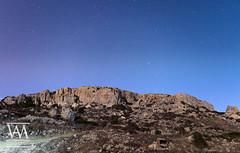 The Cliffs of Mgiebah (McCarthy's PhotoWorks) Tags: malta med mediterranean mgiebah astronomy bay beautiful cliff horizon landscape longexposure mountain night nightsky nighttime nightscape outdoor seascape sky star starry