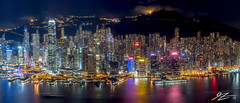 Hundreds and Thousands. And Millions. (Tim van Zundert) Tags: hong kong island china central wan chai sheung water reflection cityscape landscape skyline city night evening long exposure sky100 international commerce centre icc panorama buildings skyscraper towers mountain sony a7r mount austin victoria peak sel55f18z zeiss 55mm