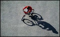 biking (kurtwolf303) Tags: bike fahrrad junge boy schatten shadow red rot canon eos 600d street bicycle strase 250v10f topf25 500v20f topf50 minimum500v 750views canont3i canoneos600d 1000v40f minimum1000v urbanlifeinmetropolis unlimitedphotos streetphotography urban tt t topf75 1500v60f person