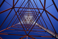 TV Tower Abstract (Jim Corwin's PhotoStream) Tags: blue red white abstract industry horizontal outside outdoors photography support triangle technology steel patterns communication link networking balance connection connect linked communicate televisiontower transmitting intertwined communicating telecast televising
