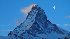 First Kiss of Dawn, 2/2 (Crystal Ski) Tags: vacation sky cloud sun sunlight moon mountain holiday snow ice dawn early ray crystal 14 peak 15 beam ridge thomson zermatt matterhorn 2014 crystalholidays crystalski crystalskiholidays