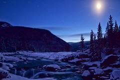 Blue World (John Andersen (JPAndersen images)) Tags: blue moon night river stars kananaskis elbowfalls freshsnow