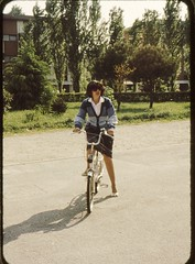 My mother in sunglasses on a bicycle Easter 1982 (Patrick_Glesca) Tags: italy bike bicycle easter cycling 1982 bici padova bicicletta pushbike mortise