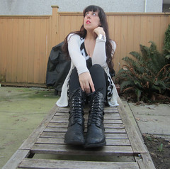 365 Day 23: There is nothing more melancholy than empty festive places. (bohemea) Tags: selfportrait self outdoors boots quote longhair tights 365 brunette bangs day23 photochallenge 2015 susanorlean theorchidthief boabeille