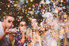Hipsters blowing confetti (theSocialOutlier) Tags: friends party summer men girl sunglasses festive happy women juice afro group hipster free blowing confetti celebration teenager africanamerican hippie imagetype photospecs multiethnicgroup