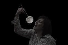 Luna nueva perpetua... (Rebeca de Sousa Santana) Tags: portrait moon black person persona noche asia luna montage montaje comer alina palillos mario
