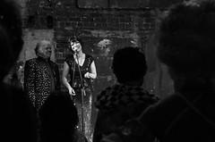 Final Words (elizunseelie) Tags: britannia panopticon musichall theatre stage event live variety burlesque vaudeville show people portrait costumes glamour historic brickwall pentax k5 dark tamron low light moisture festival black white monochrome song crowd silhouette woman bob