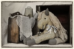 Toys and spurs (Mulewings~) Tags: stilllife blackandwhitish faded memories toys boxes spurs bells lace framed