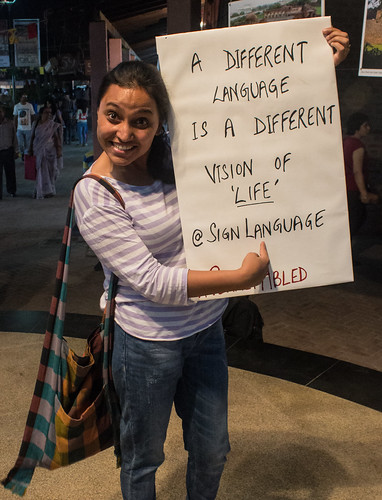My disability doesn't stop my wanderlust: 'A different language is a different vision of 'Life' @SIgnLanguage', reads the poster of our traveller Rupmani.