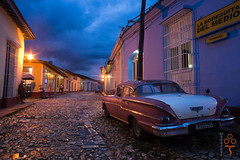 Old Town (manuelchopard) Tags: color city cityscape car oldtimer colonial street trinidad bluehour storm rain travel cuba caribbean minolta24mm28 rokkor lights twilight sonya7