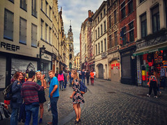 City Scene in Ghent, Belgium (` Toshio ') Tags: toshio ghent belgium gentsefesteen city oldtown street streetscene people festival architecture europe european europeanunion woman man dress shops restaurant tower souvenirs iphone
