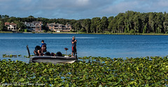Fishing on Lake Tarpon (Thomas Gremaud) Tags: trees blue houses fishing waterlillies green lake recreation realestate boat