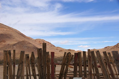The Art Of Imperfection (nedlugr) Tags: california ca mojavedesert desert fence sky clouds mountains disarray omot