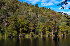 Fall in Beavers Bend State Park (MikeInOwasso) Tags: oklahoma beaver bend state park cypress tree color fall river water sky clouds south contrast landscape scenic trees green orange rock formation outcropping