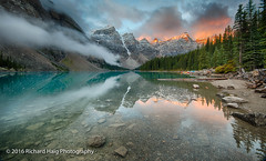 Sunrise at Moraine Lake (RichHaig) Tags: landscape nikonnikkor1424mmf28 morainelakelodge water mountains richhaig gitzotripod clouds trees lake alberta sunrise rocks canada reflections morainelake nikond800 snow