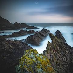 Falling Under (Augmented Reality Images (Getty Contributor)) Tags: canon clouds coastline cullen landscape leefilters littlestopper longexposure morayshire rocks scotland seascape sunrise water waves