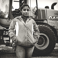 291 | 366 | V (Randomographer) Tags: project366 human woman tractor wheel portrait work working tough strong jacket black white monotone 291 366 v people